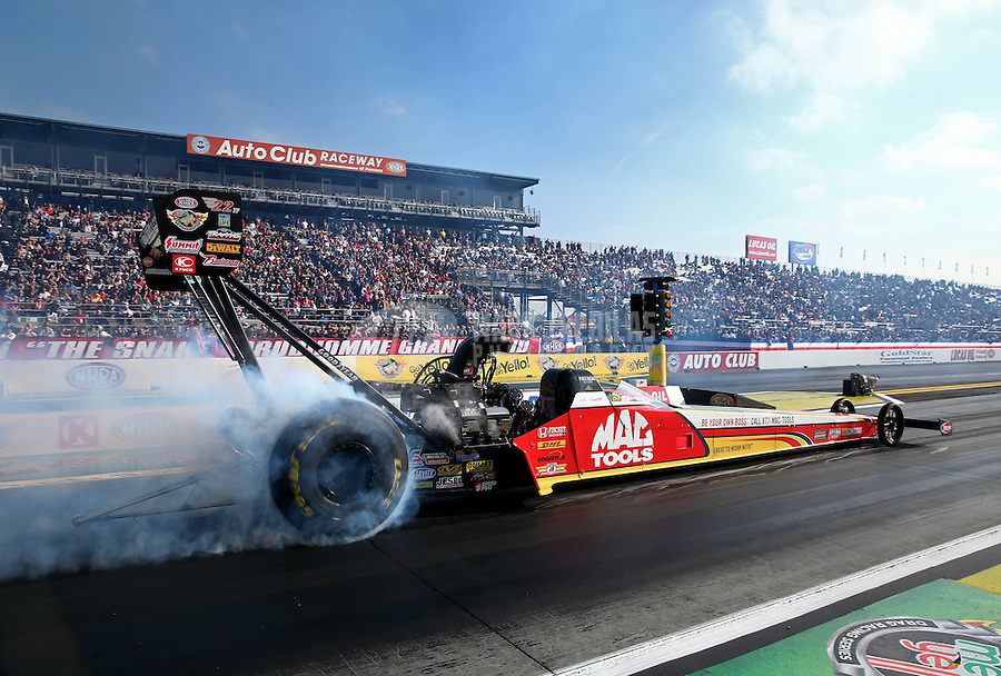 Feb 9, 2014; Pomona, CA, USA; NHRA top fuel dragster driver Doug Kalitta during the Winternationals at Auto Club Raceway at Pomona. Mandatory Credit: Mark J. Rebilas-