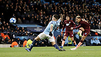1899 Hoffenheim's Joelinton shoots despite the attentions of Manchester City's Nicolas Otamendi<br /> <br /> Photographer Rich Linley/CameraSport<br /> <br /> UEFA Champions League Group F - Manchester City v TSG 1899 Hoffenheim - Wednesday 12th December 2018 - The Etihad - Manchester<br />  <br /> World Copyright © 2018 CameraSport. All rights reserved. 43 Linden Ave. Countesthorpe. Leicester. England. LE8 5PG - Tel: +44 (0) 116 277 4147 - admin@camerasport.com - www.camerasport.com