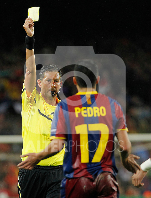The referee Frank De Bleeckere show the yellow card to FC Barcelona's Pedro Rodriguez during UEFA Champions League match.May 3,2011.(ALTERPHOTOS/Acero)