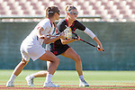 Los Angeles, CA 04/22/16 - Michaela Michael (USC #2) and unidentified Stanford player(s) in action during the NCAA Stanford-USC Division 1 women lacrosse game at the Los Angeles Memorial Coliseum.  USC defeated Stanford 10-9/