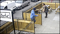 BNPS.co.uk (01202 558833)<br />Pic:   BuffaloBar/BNPS<br /> <br /> CCTV still image of the man approching his dog outside the bar.<br /> <br /> The shocking moment a thug rams his pet dog head-first into a fence and repeatedly punches it has been caught on CCTV.<br /> <br /> The yob owner became angry that the black pitbull-type dog ran off into the front garden of a bar.<br /> <br /> After catching up with the animal, the man grabbed it by the neck and slammed it into the wooden fence.