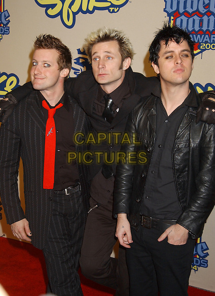 GREEN DAY - TRE COOL, MIKE DIRNT & BILLIE JOE ARMSTRONG.Spike TV Video Game Awards 2004 held at the Barker Hangar. .14 December 2004 .half length, red tie, pinstripe, black leather jacket.www.capitalpictures.com.sales@capitalpictures.com.© Capital Pictures.
