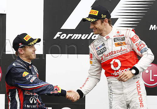 12 06 2011  FIA Formula One World Championship 2011 Grand Prix of Canada 01 Sebastian Vettel ger Red Bull Racing shakes the hand of winner 04 Jenson Button GBR Vodafone McLaren Mercedes