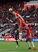 5th November 2017, Riverside Stadium, Middlesbrough, England; EFL Championship football, Middlesbrough versus Sunderland; Daniel Ayala of Middlesbrough heads clear from Marc Wilson of Sunderland with Ashley Fletcher of Middlesbrough helping out