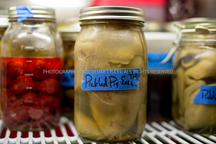 10/16/2014&mdash;Seattle, WA, USA<br /> <br /> Derek Ronspies, owner and chef at Le Petit Cochon in Seattle&rsquo;s Fremont neighborhood. PIckled ears in the restaurant fridge.<br /> <br /> Photograph by Stuart Isett<br /> &copy;2014 Stuart Isett. All rights reserved.
