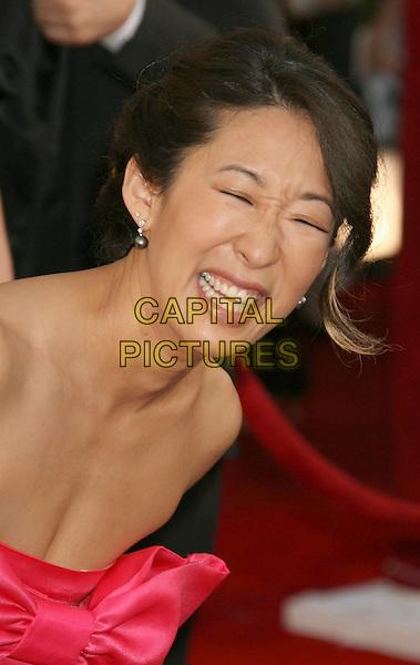 SANDRA OH.14th Annual Screen Actors Guild Awards held at the Shrine Auditorium, Los Angeles, California, USA..January 27th, 2008.arrivals SAG headshot portrait strapless laughing funny face.CAP/ADM/RE.©Russ Elliot/AdMedia/Capital Pictures. *** Local Caption *** .