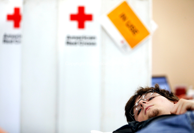 Winsted, CT- 15 June 2015-061515CM01-  Jagger Dillon of Winsted donates blood during a blood drive at the Winsted Ambulance headquarters in Winsted on Monday.  The drive was put on by the Winsted Area Ambulance Association, which holds a blood drive every two to three months said Amber Wald, blood drive coordinator.  Wald said the drive usually receives 25-40 donators.   Christopher Massa Republican-American