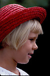Danish girl in a red hat on the island of Bornholm, Denmark