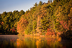 Autumn sunrise at Walden Pond, home of the Transcendentalist author David Thoreau, in Concord, MA, USA