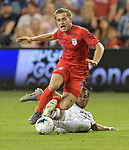 Djordje Mihailovic (20) of the United States is slide-tackled by Michael Murillo (23) of Panama during their Gold Cup match on June 26, 2019 at Children's Mercy Park in Kansas City, KS.<br /> Tim VIZER/AFP