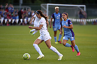 Kansas City, MO - Saturday May 28, 2016: FC Kansas City midfielder Erika Tymrak (15) is chased by Orlando Pride midfielder Samantha Witteman (26). FC Kansas City defeated Orlando Pride 2-0 during a regular season National Women's Soccer League (NWSL) match at Swope Soccer Village.