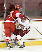 Tara Watchorn (BU - 27), Caitlin Walsh (BC - 11) - The Boston College Eagles defeated the Boston University Terriers 2-1 in the opening round of the Beanpot on Tuesday, February 8, 2011, at Conte Forum in Chestnut Hill, Massachusetts.