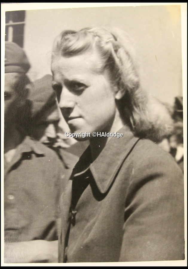BNPS.co.uk (01202 558833)<br /> Pic: HAldridge/BNPS<br /> <br /> Irma Grese, the so-called 'Bitch of Belsen'.<br /> <br /> A Spitfire pilot's own snaps of some of the Nazi's most notorious murderers after they were detained for their horrific war crimes have been found in an old suitcase.<br /> <br /> RAF Officer Keith Parfitt took his own photos of the monsters, who included Franz Hossler, a commander at Aushwitz concentration camp and then deputy commandant of Burgen-Belsen, and Irma Grese, the so-called 'Bitch of Belsen'.<br /> <br /> The pictures have been discovered in an old case by relatives and are now being sold by Henry Aldridge and Son of Devizes, Wilts.