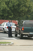Washington, DC - October 4, 2002 -- Washington, DC Metropolitan Police convene in a parking lot across Kalmia Street, NW from where 72 year-old Pascal Charlot was shot and killed in Washington, DC on 3 October, 2002.  DC and Montgomery County Police are investigating whether or not there was a link between this murder and the 5 murders in Montgomery County.<br /> Credit: Ron Sachs / CNP<br /> (RESTRICTION: NO New York or New Jersey Newspapers or newspapers within a 75 mile radius of New York City)