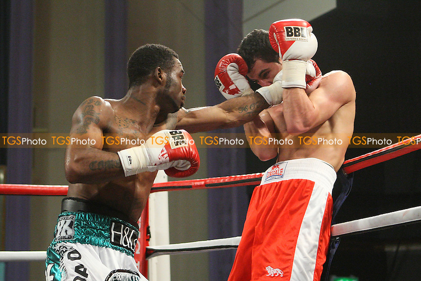 Larry Ekundayo (green/white shorts) defeats Ben Deghani in a Welterweight boxing contest at the Troxy, Limehouse, London, promoted by Spencer Fearon/Hard Knocks Promotions - 23/03/12 - MANDATORY CREDIT: Gavin Ellis/TGSPHOTO - Self billing applies where appropriate - 0845 094 6026 - contact@tgsphoto.co.uk - NO UNPAID USE.