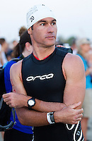 12 MAR 2011 - ABU DHABI, UAE - Craig Alexander waits for the start of the Abu Dhabi International Triathlon (PHOTO (C) NIGEL FARROW)