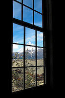 Mountains and moraine visible through a window at the Kennicott Mine power plant.