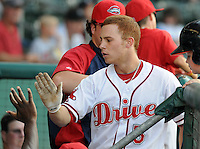 Infielder Sean Coyle (5) of the Greenville Drive is congratulated after scoring a run in a game against the Lakewood BlueClaws on July 12, 2011, at Fluor Field at the West End in Greenville, South Carolina. (Tom Priddy/Four Seam Images)