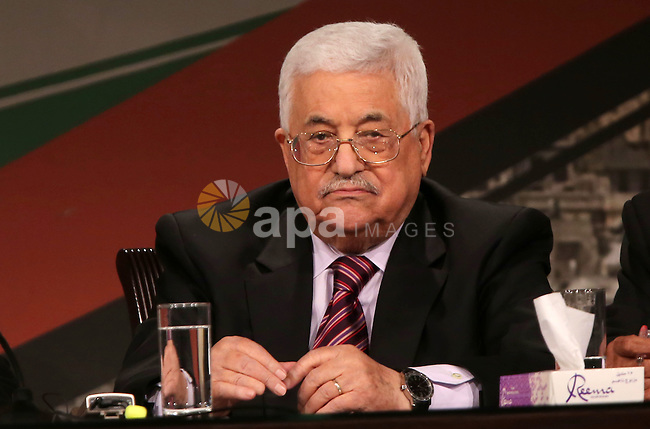 Palestinian President Mahmoud Abbas attends the opening ceremony of the 7th Fatah Congress on November 29, 2016, at the Muqataa, the Palestinian Authority headquarters, in the West Bank city of Ramallah. Abbas's Fatah re-elected him party head as the movement opened its first congress since 2009 with talk mounting of who will eventually succeed the 81-year-old. Photo by Shadi Hatem