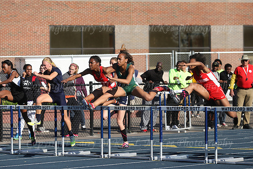 Oakland County Track Championship at Waterford Mott High School, May 22, 2015. Photos: Larry McKee, L McKee Photography. PLEASE NOTE: ALL PHOTOS ARE CUSTOM CROPPED. THIS CAN CAUSE EXTRA WHITE SPACE AROUND BORDERS. BEFORE PURCHASING AN IMAGE, PLEASE CHOOSE PROPER PRINT FORMAT TO BEST FIT IMAGE DIMENSIONS. L McKee Photography, Clarkston, Michigan. L McKee Photography, Specializing in Action Sports, Senior Portrait and Multi-Media Photography. Other L McKee Photography services include business profile, commercial, event, editorial, newspaper and magazine photography. Oakland Press Photographer. North Oakland Sports Chief Photographer. L McKee Photography, serving Oakland County, Genesee County, Livingston County and Wayne County, Michigan. L McKee Photography, specializing in high school varsity action sports and senior portrait photography.