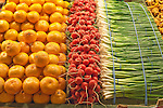 Oranges, readishs and green onions on display, Pike Street Market, seattle, WA