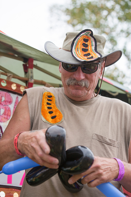 Robert Lockheed, an artist-in-residence at Collaborative Art International in Athens, Ohio, makes balloon hats at the Pawpaw Festival on Sept. 17, 2016.