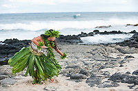 Hula kahiko dancer in ti leaf skirt at Sandy Beach, East O'ahu.