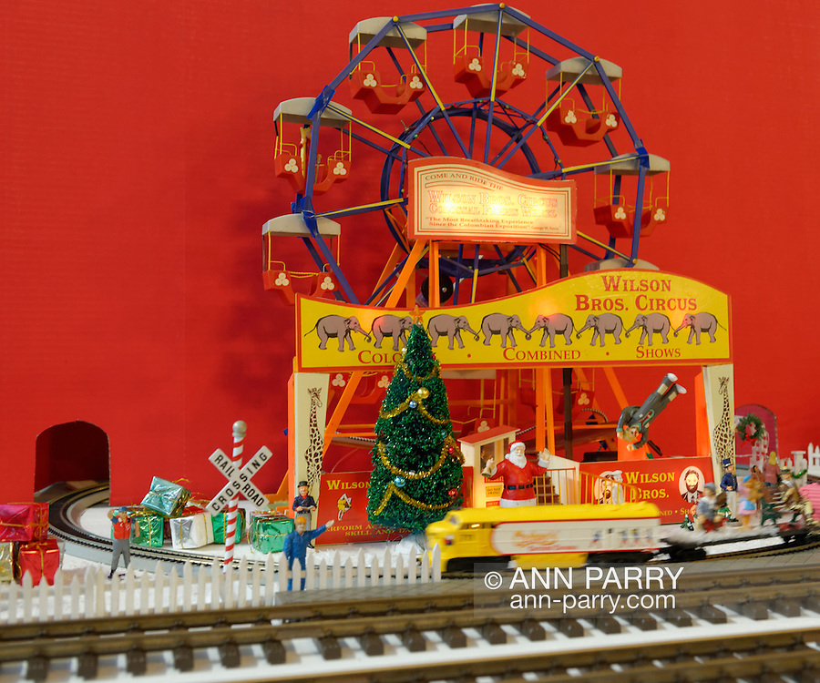 Dec. 26, 2012 - Garden City, New York, U.S. - The Long Island Garden Railway Society large-scale model train display is a festive winter holiday attraction in the vast 3-floor atrium of Cradle of Aviation museum, until shortly after New Years Day 2013. This is a ferris wheel in the colorful circus themed part of the display. LIGRS shares the knowledge, fun, and camaraderie of large-scale railroading both indoors and in the garden, and is family oriented.