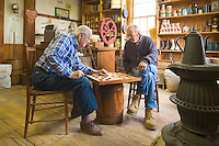 Gentlemen playing checkers in the General Store.