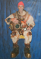 BNPS.co.uk (01202 558833)<br /> Pic: PhilYeomans/BNPS<br /> <br /> Ray Ives Locker<br /> <br /> Ray in his old dive gear.<br /> <br /> Old man of the sea Ray Ives has opened his very own Davy Jones' locker of hundreds of nautical treasures he has salvaged from the seabed.<br /> <br /> Ray(77) has spent 40 years amassing a huge trove of historical artefacts that he has found during thousands of deep sea dives off the British coast.<br /> <br /> Ray's watery Aladdins cave includes canon balls, muskets, swords and even the bell from an ocean liner sunk by a German U-boat in the First World War.<br /> <br /> For years Ray had stuffed his collection into a tiny shed in the back garden of his home in Plymouth, Devon.<br /> <br /> But now the fascinating archive has now gone on display to the public in a ramshackle museum made from shipping containers.