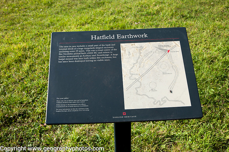 English Heritage information board for the Neolithic Hatfield earthwork site at Marden, Wiltshire, England