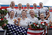 Team USA, with Victoria Opitz, Meghan Musnicki, Amanda Polk, Lauren Schmetterling, Grace Luczak, Caroline Lind, Elanor Logan, Heidi Robins and Katelin Snyder of the USA, Women's Eight celebrate after winning the Final event of the World Rowing Championships in Amsterdam, Netherlands, Sunday Aug. 31, 2014. - Photo by Paulo Amorim