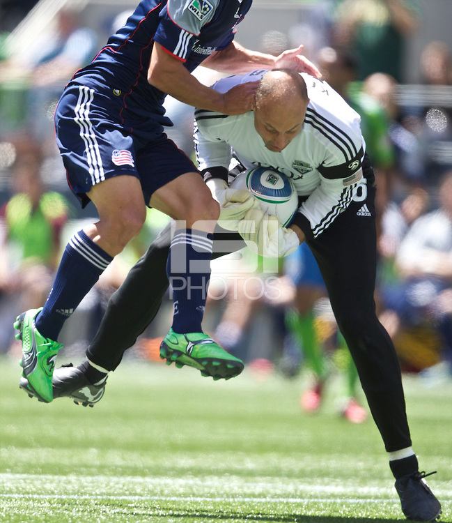 Seattle Sounders FC goalkeeper Kasey Keller makes a save during play against the New England Revolution at .CenturyLink Field in Seattle Sunday June 26, 2011. The Sounders won the game 2-1.   during play between the Seattle Sounders FC and the New England Revolution at .CenturyLink Field in Seattle Sunday June 26, 2011. The Sounders won the game 2-1.