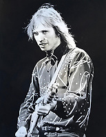 Tom Petty performs at the Concord Pavilion in the early 1990's.Tom Petty, a singer, songwriter and guitarist who melded California rock with a deep, stubborn Southern heritage to produce a long string of durable hits, died on Monday in Los Angeles. He was 66. (Photo by Alan Greth)