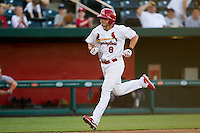 Chris Swauger (8) of the Springfield Cardinals heads to home plate after hitting a solo home run during a game against the Midland RockHounds at Hammons Field on July 11, 2011 in Springfield, Missouri. (David Welker / Four Seam Images)