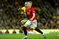 27th Ocotber 2019; Carrow Road, Norwich, Norfolk, England, English Premier League Football, Norwich versus Manchester United; Scott McTominay of Manchester Utd is under pressure from Teemu Pukki of Norwich City - Strictly Editorial Use Only. No use with unauthorized audio, video, data, fixture lists, club/league logos or 'live' services. Online in-match use limited to 120 images, no video emulation. No use in betting, games or single club/league/player publications