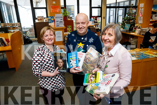 Kerry County Library Staff with the most popular books of 2017, from Left: Noirin O'Keeffe, John O'Connell and Aileen Lynch.
