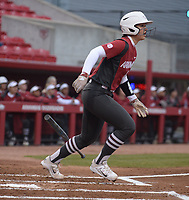NWA Democrat-Gazette/ANDY SHUPE<br /> Arkansas catcher Kayla Green connects to score a run against Southeast Missouri Thursday, Feb. 21, 2019, during the first inning at Bogle Park on the university campus in Fayetteville.