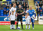 St Johnstone v Bolton....02.08.10  Pre-Season Friendly.Kevin Davies, Ref Willie Collum and Jody Morris with the mascots.Picture by Graeme Hart..Copyright Perthshire Picture Agency.Tel: 01738 623350  Mobile: 07990 594431
