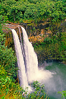 Gorgeous Wailua Falls surrounded by lush vegetation on the island of Kauai.