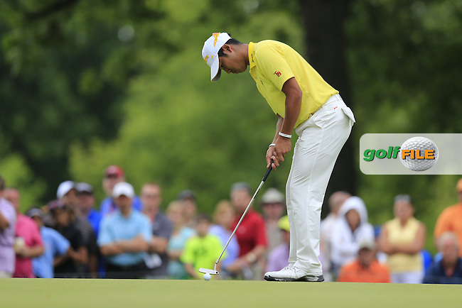 Hideki Matsuyama (JPN) putts on the 13th green during Friday's Round 1 of the 2013 Bridgestone Invitational WGC tournament held at the Firestone Country Club, Akron, Ohio. 2nd August 2013.<br /> Picture: Eoin Clarke www.golffile.ie