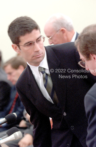 "Washington, DC - February 7, 2002 -- Michael J. Kopper, former Managing Director; Enron Global Finance departs a hearing of the United States House of Representatives Energy and Commerce Subcommittee on Oversight and Investigations on ""The Financial Collapse of the Enron Corporation"". after invoking his right to refuse self incrimination allowed under the 5th Amendment of the United States Constitution..Credit: Ron Sachs / CNP"