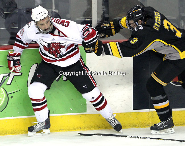 Michigan Tech's Brad Stebner tugs at UNO's Brent Gwidt. UNO defeated Michigan Tech 5-2 Thursday night at Qwest Center Omaha. (Photo by Michelle Bishop)