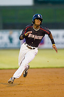 Tim Anderson (2) of the Kannapolis Intimidators hustles towards third base against the Savannah Sand Gnats at CMC-Northeast Stadium on August 20, 2013 in Kannapolis, North Carolina.  The Sand Gnats defeated the Intimidators 5-2.  (Brian Westerholt/Four Seam Images)