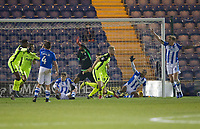 Amidst protestations from the goalmouth scramble from the host players, Jayden Stockley of Exeter City turns to celebrate the equaliser,during Colchester United vs Exeter City, Sky Bet EFL League 2 Football at the JobServe Community Stadium on 24th November 2018