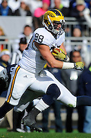 21 November 2015:  Michigan TE Jake Butt (88) runs through a tackle after a catch. The Michigan Wolverines defeated the Penn State Nittany Lions 28-16 at Beaver Stadium in State College, PA. (Photo by Randy Litzinger/Icon Sportswire)