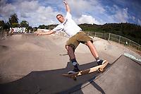 Caucasian male skateboarding at Banzai Skatepark on the North Shore of Oahu, Hawaii