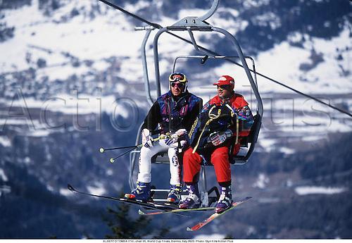 ALBERTO TOMBA (ITA), chair lift, World Cup Finals, Bormio, Italy 9503. Photo: Glyn Kirk/Action Plus...1995.skiing.winter sport.winter sports.wintersport.wintersports.alpine.ski.skier.skiers.man
