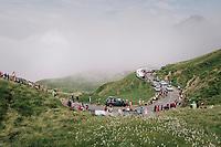 splintered riders up the last climb of the 2018 Tour: the Col d'Aubisque (HC/1709m/16.6km@4.9%)<br /> <br /> Stage 19: Lourdes &gt; Laruns (200km)<br /> <br /> 105th Tour de France 2018<br /> &copy;kramon
