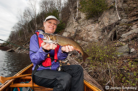Woman angler holding up a splake.